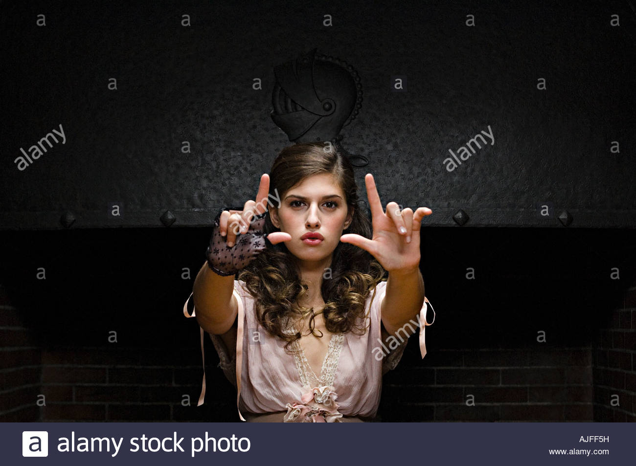 Hispanic woman making hand gestures - Stock Image