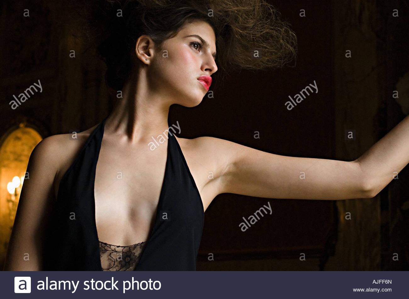 Intrigued hispanic woman - Stock Image