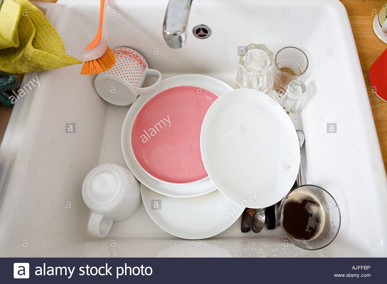 Washing up in sink - Stock Image