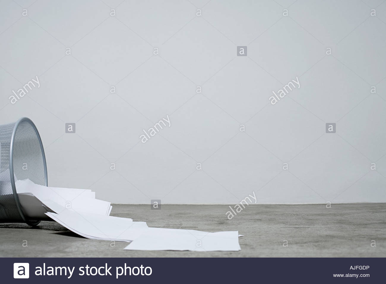 Paper spilling out of a bin - Stock Image