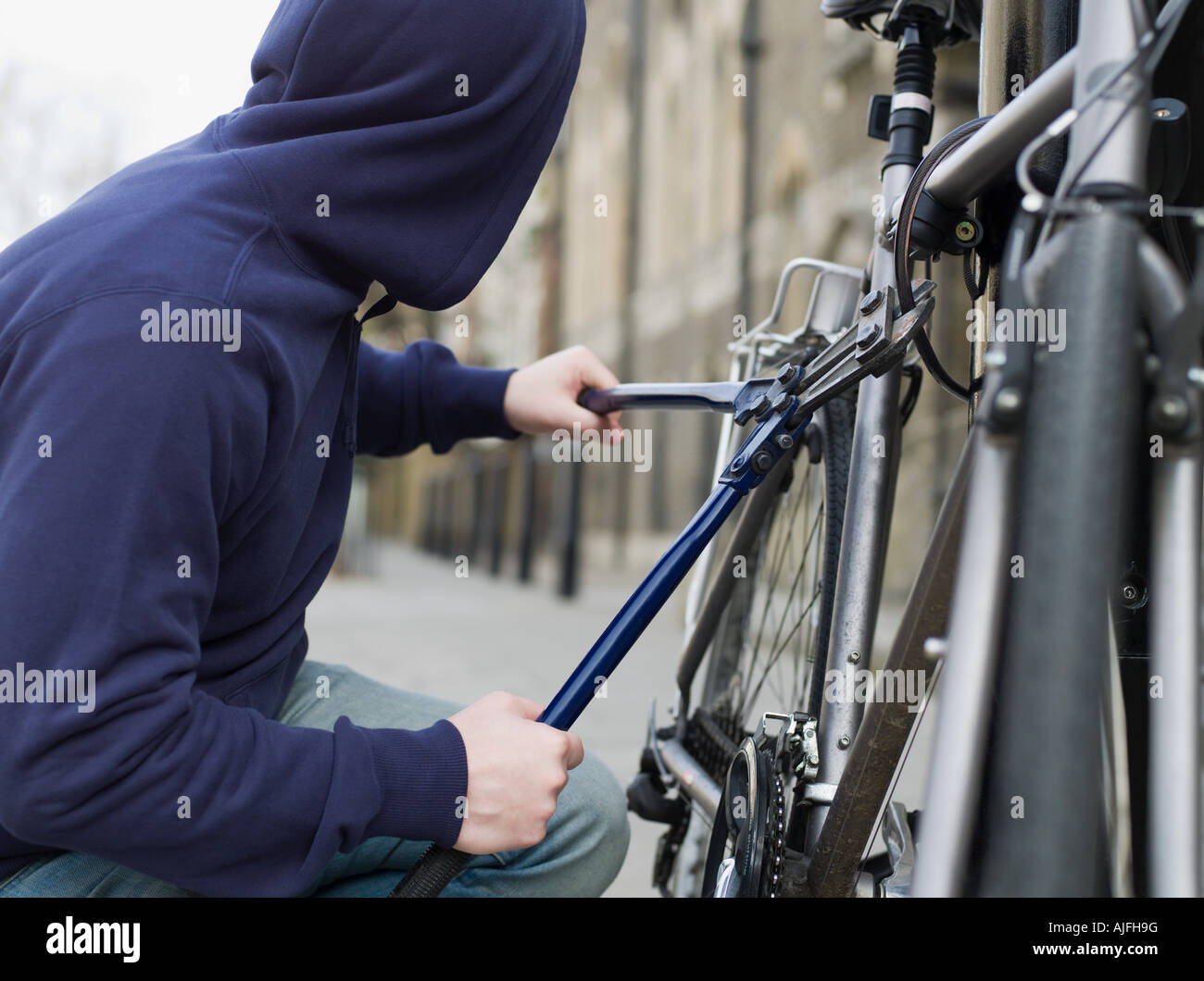 A thief stealing a bike - Stock Image