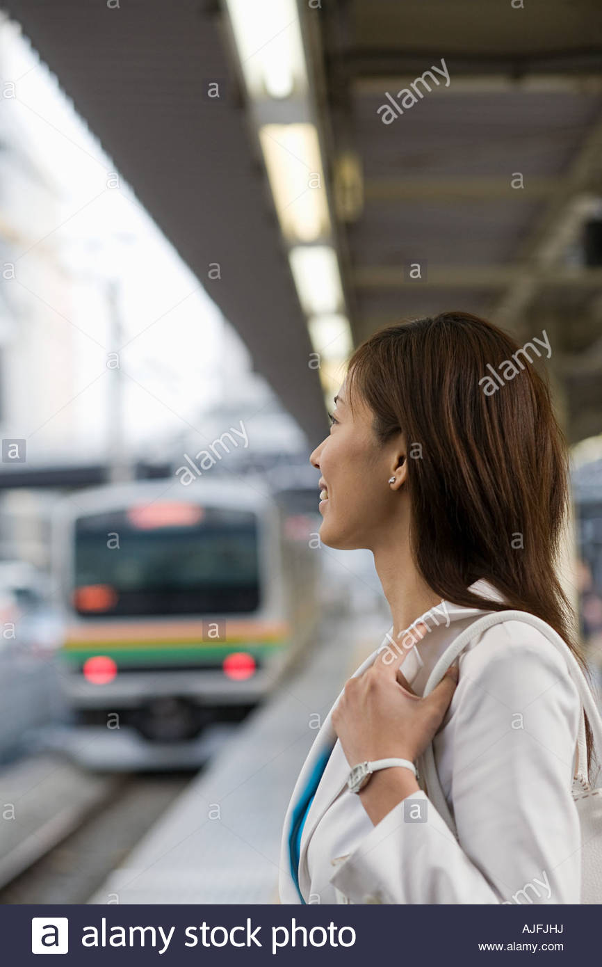 Woman on railway platform - Stock Image