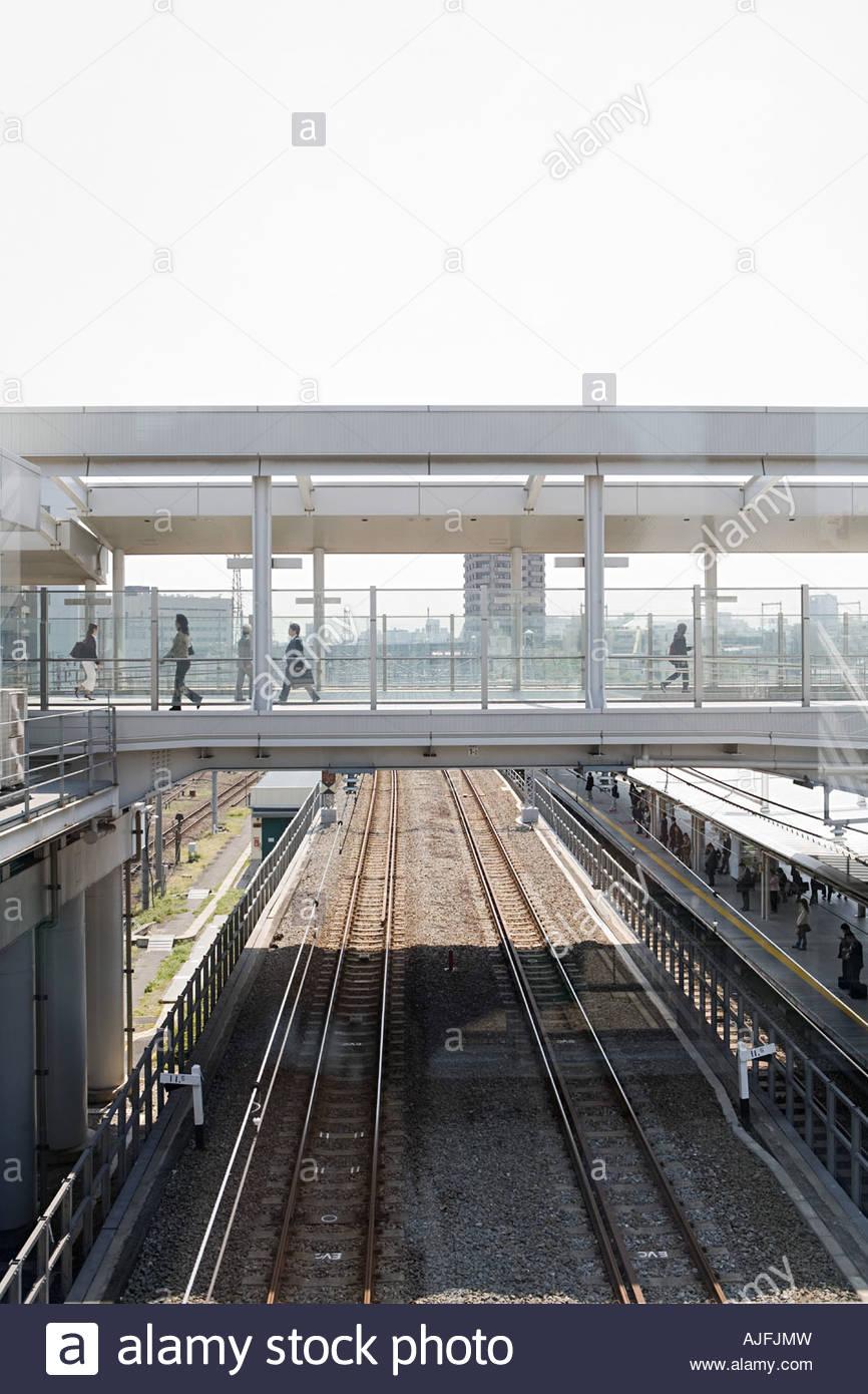 Bridge over railway tracks - Stock Image