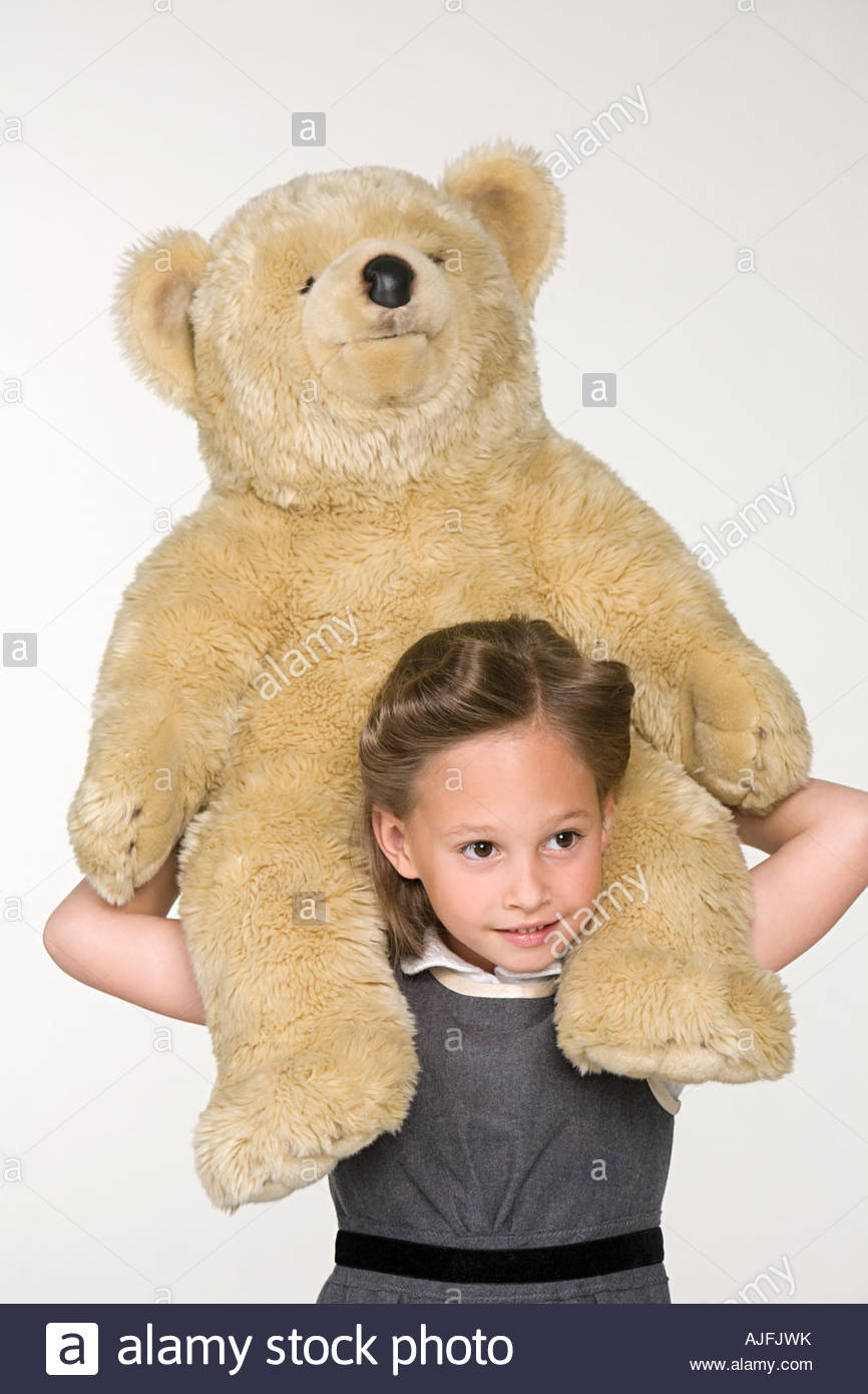 A girl shoulder carrying a tedy bear Stock Photo