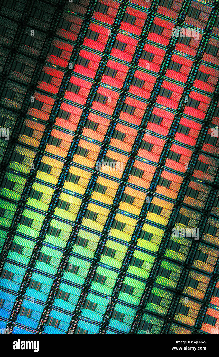 Silicon Wafer with Etched Computer Circuits Diffracting Light - Stock Image