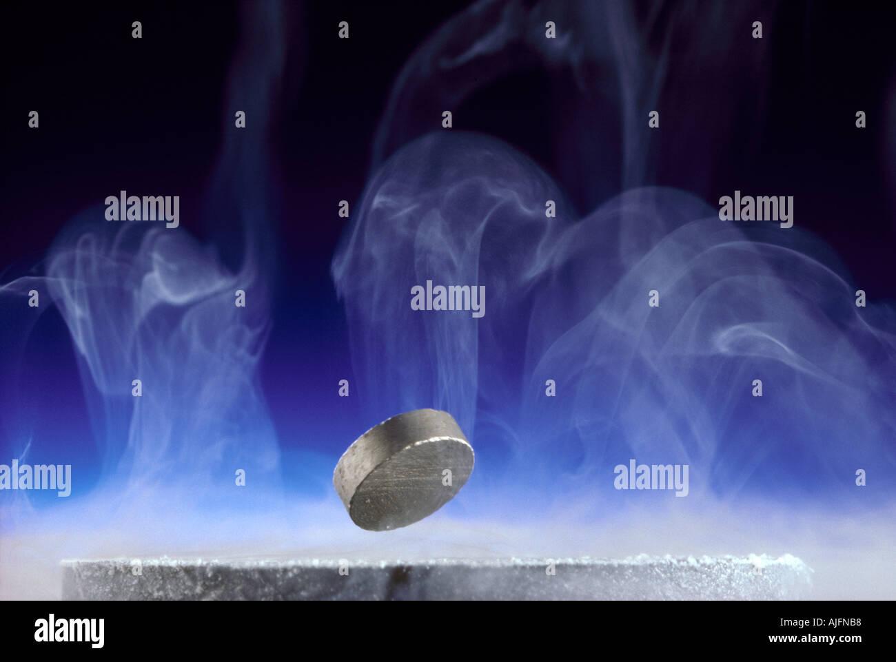 Superconducting Yttruim Barium Copper Oxide Composite Levitating Samarium Cobalt Magnet & Illustrating the Meissner Effect - Stock Image