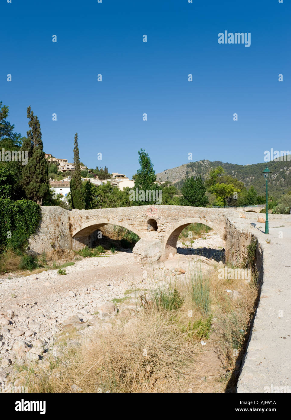Roman Bridge in the old town of Pollensa (Pollenca), Mallorca, Spain Stock Photo