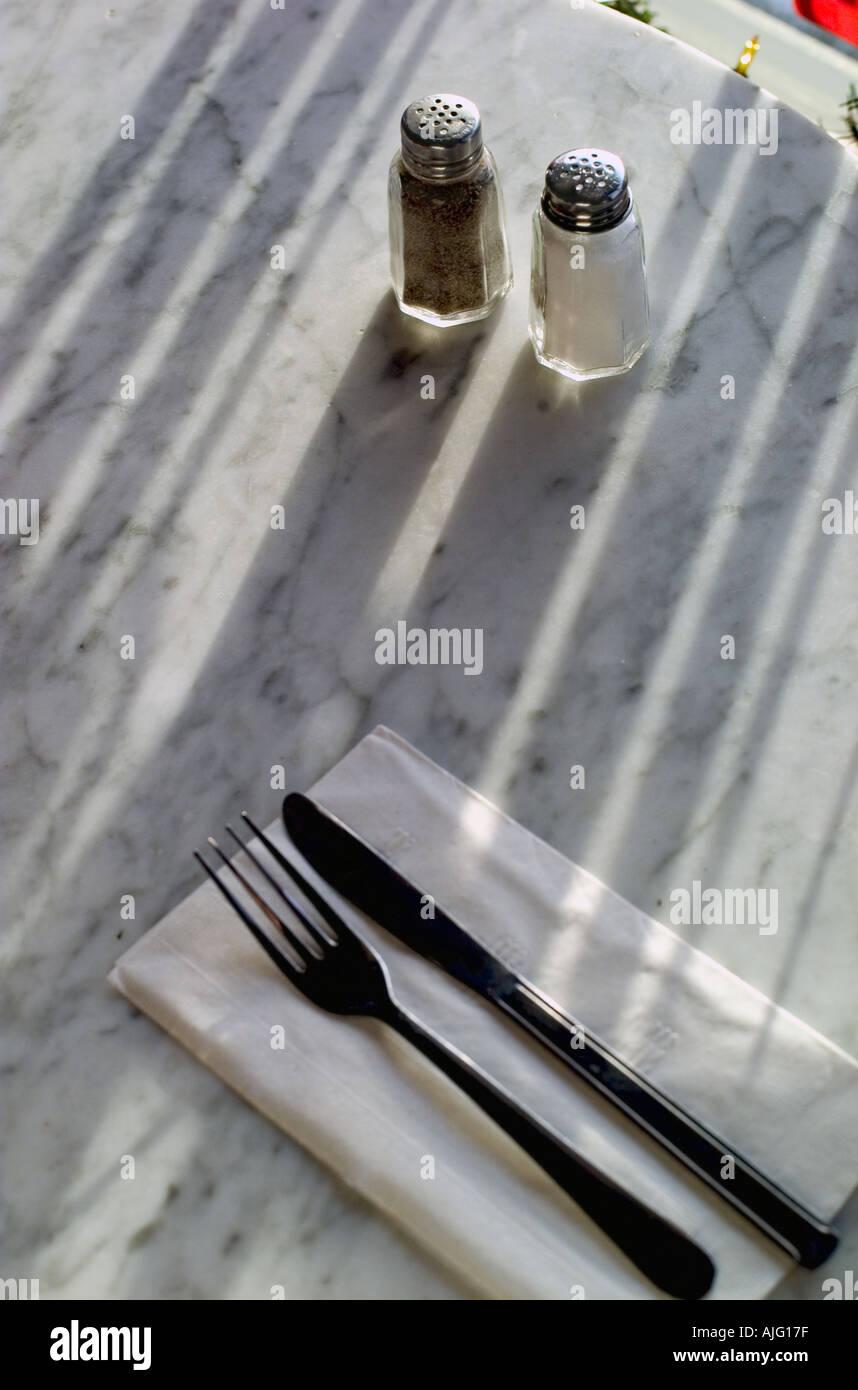 Restaurant table setting Still life with utensils salt pepper in ...