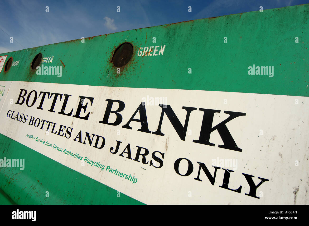 A bottle bank at a recycling centre in Exeter, Devon, UK. - Stock Image
