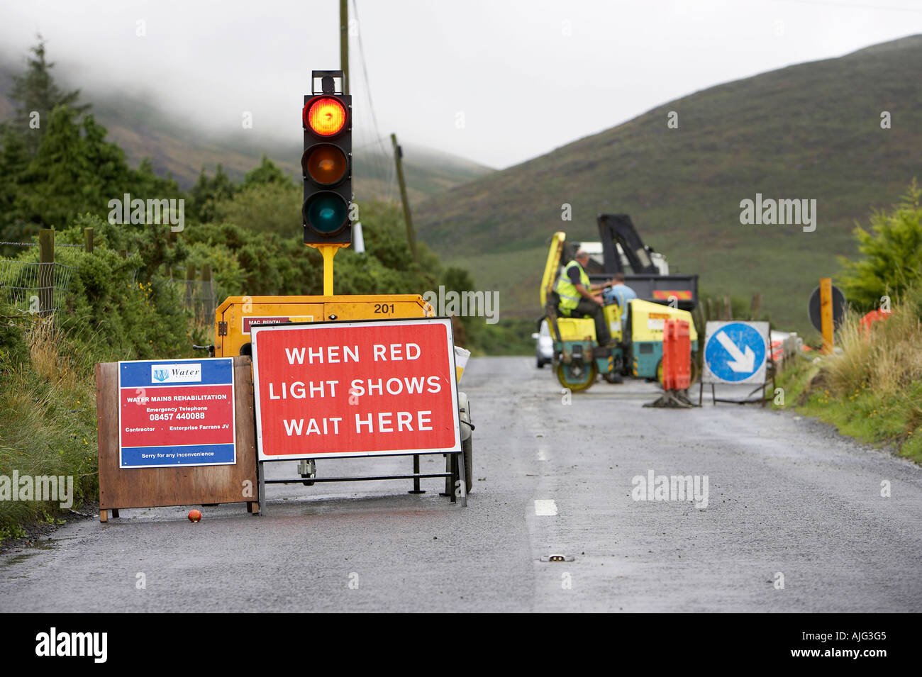 temporary red traffic light at roadworks in the mourne mountains county down northern ireland - Stock Image