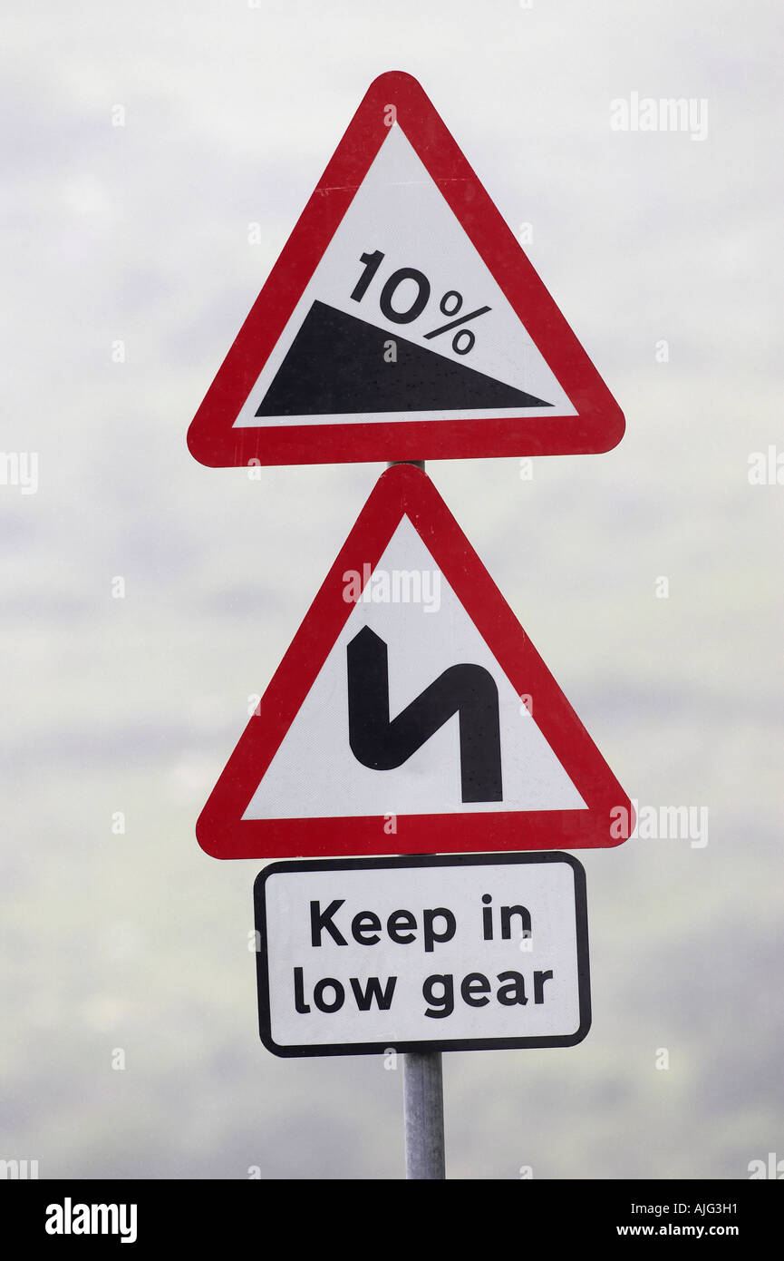 steep and windy road keep in low gear 10 triangular danger signs on mountain road in the mourne mountains - Stock Image