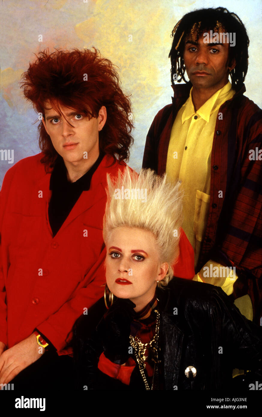THOMPSON TWINS in 1984 from left Tom Bailey Alannah Currie and Joe Leeway - Stock Image