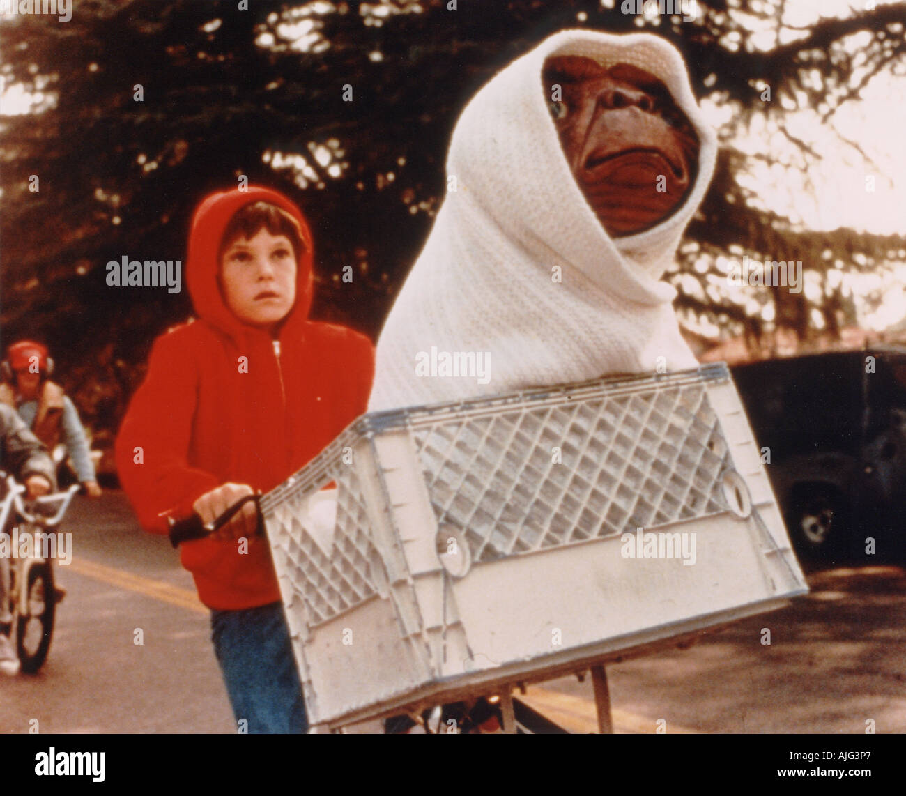 E T 1982 Universal film directed by Stephen Spielberg with Henry Thomas riding the bike - Stock Image