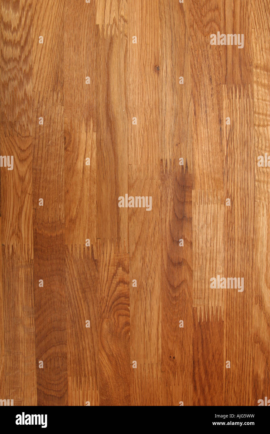 closeup of a table made of oak with solid boards - Stock Image