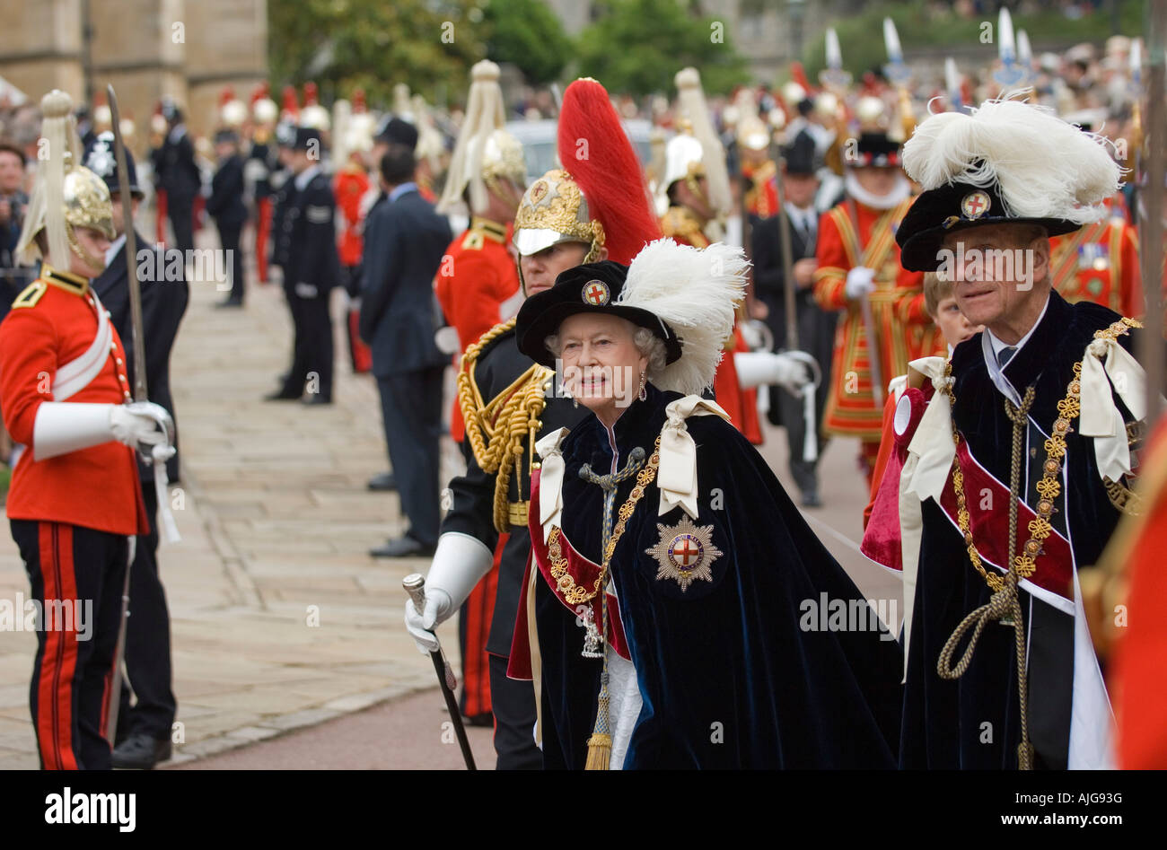 HM the Queen and HRH the Duke of Edinburgh during the Order of the Garter Procession outside St George's Chapel - Stock Image