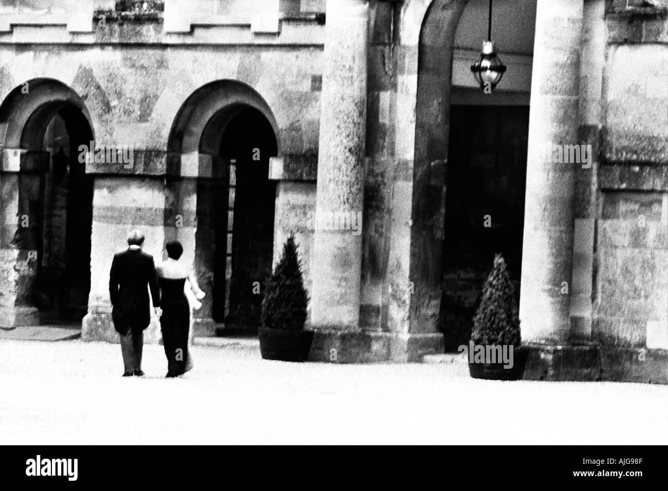 Butlers come to pick up luggage at hotel Clivedon - Stock Image