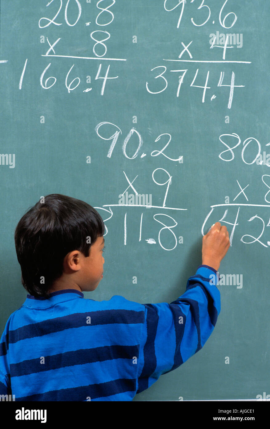 Math Girl Writing Numbers On Stock Photos & Math Girl Writing ...
