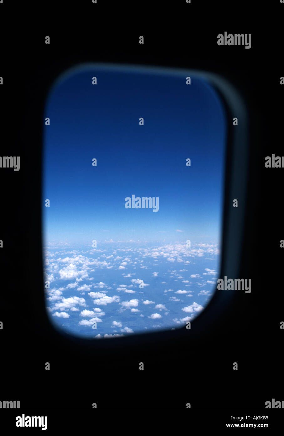 Portal to the stratosphere View from an aircraft at 35000 feet Overlooking Kenya East Africa Scattered clouds below - Stock Image