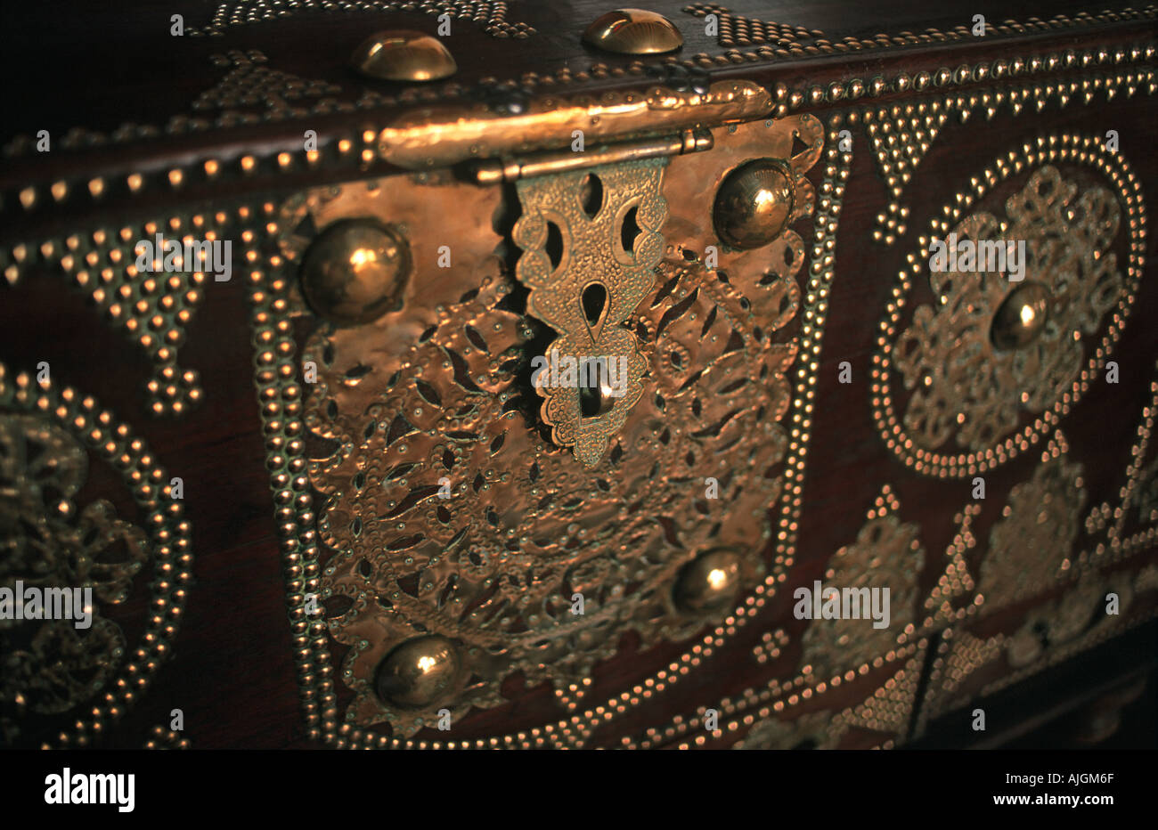 Ornate chest with brass filigree decoration Arab decor can be found in all the opulent hotels in Stone Town Zanzibar Tanzania - Stock Image