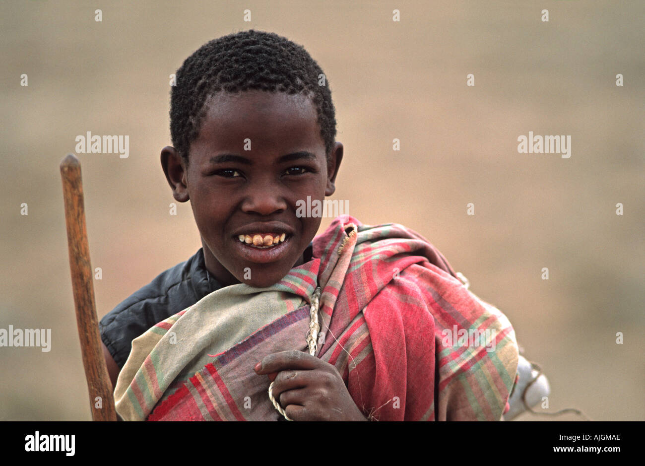 Young Masai herder in tribal community adjacent to the cattle market north of Arusha Tanzania East Africa - Stock Image