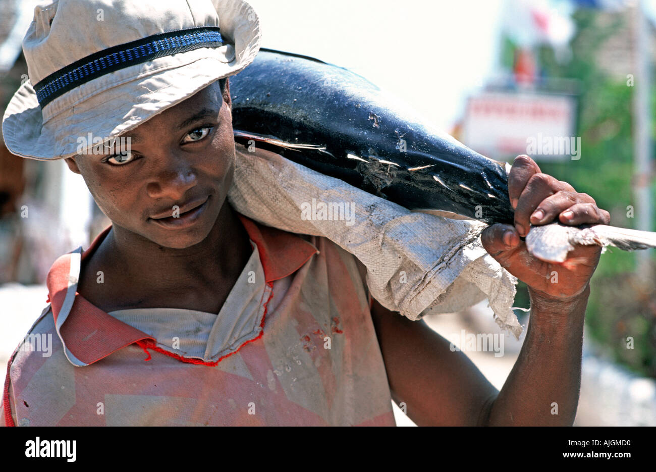 Zanzibari fisherman with freshly caught tuna Nungwi village northern tip of Zanzibar Tanzania East Africa - Stock Image