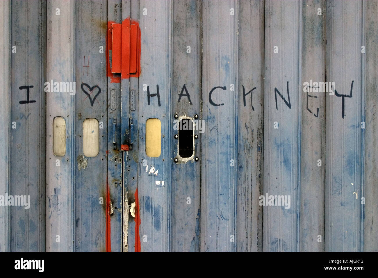 Graffiti on a gate in the London Borough of Hackney, England. - Stock Image
