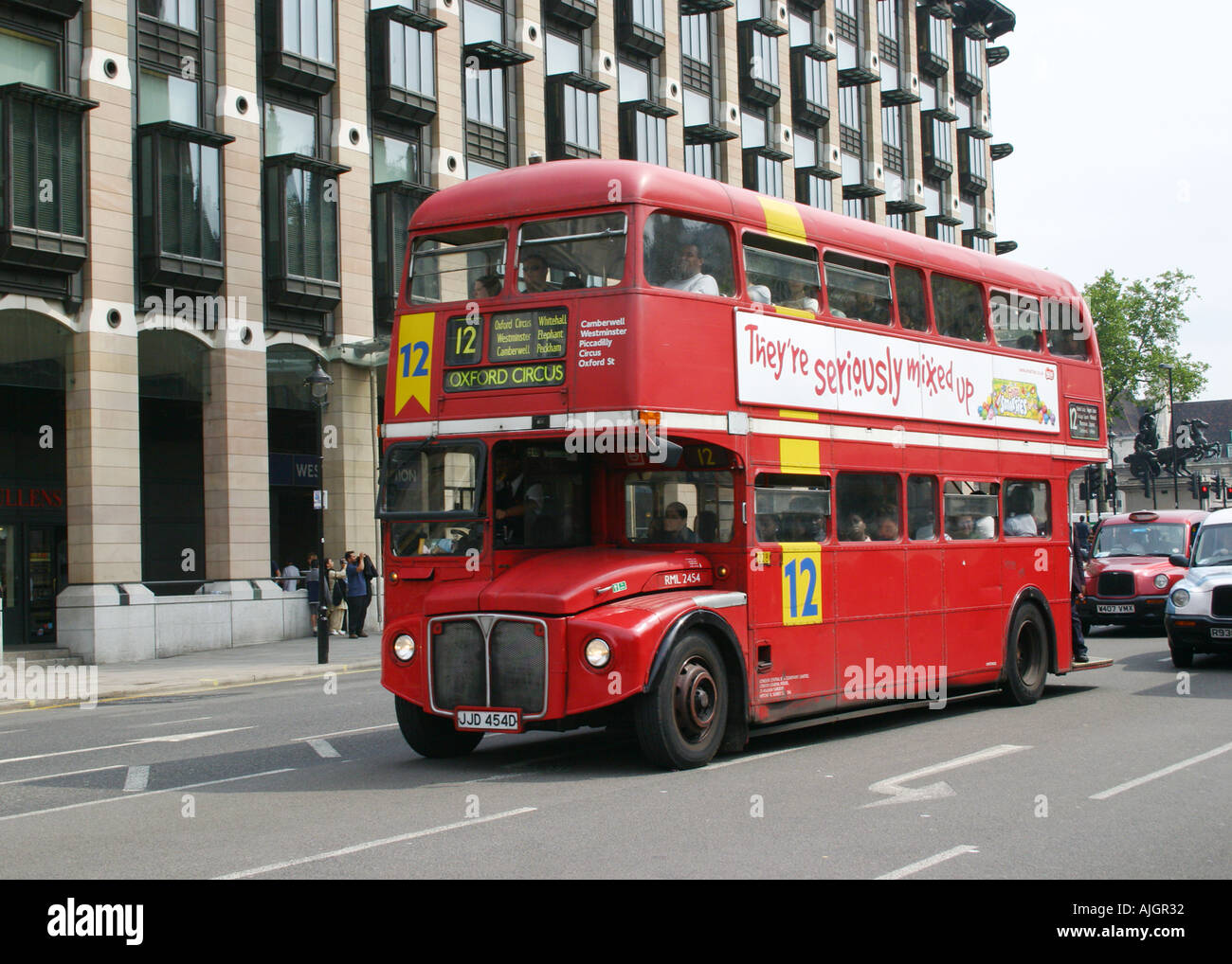 London Routemaster Bus RML 2454 on Route 12 passing Big Ben