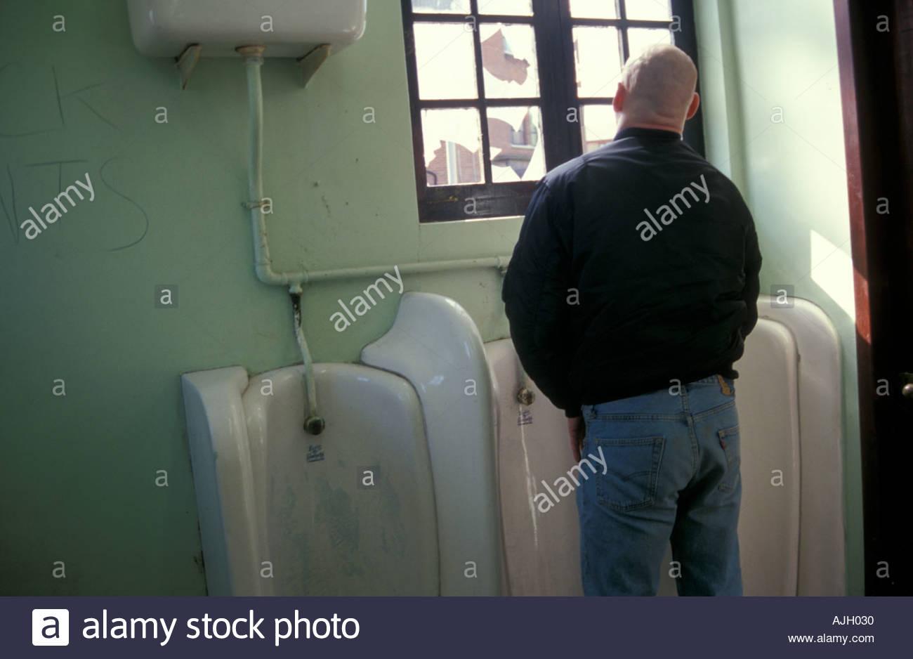 Man Using Public Toilet UK