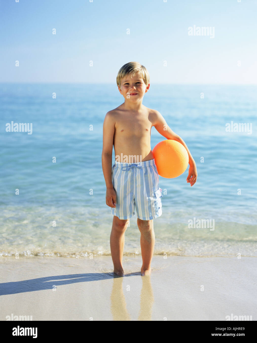 Boy with a beach ball - Stock Image