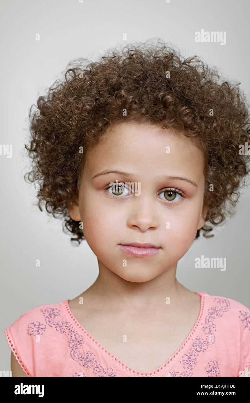 Girl with curly hair - Stock Image