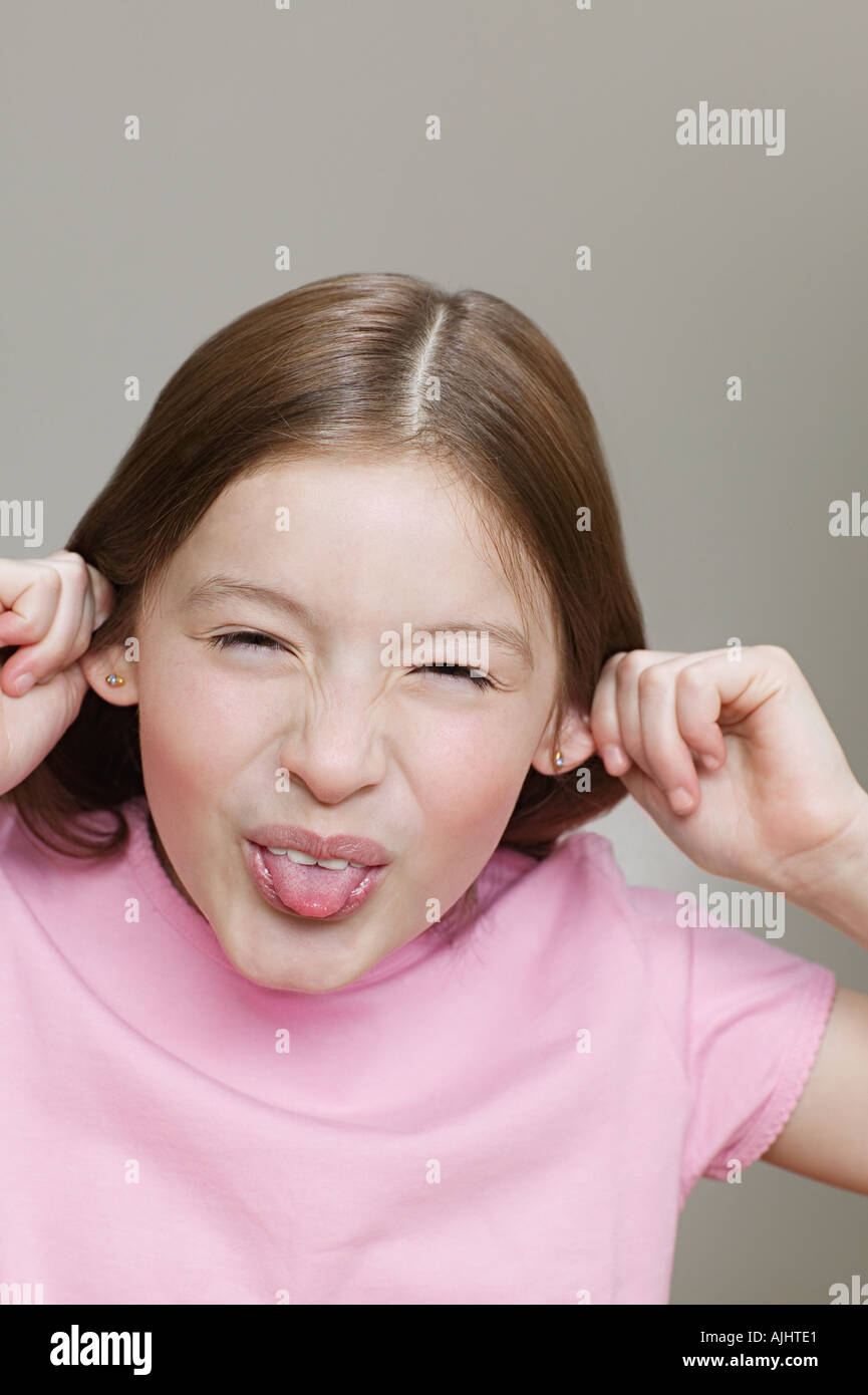 Girl making a face - Stock Image