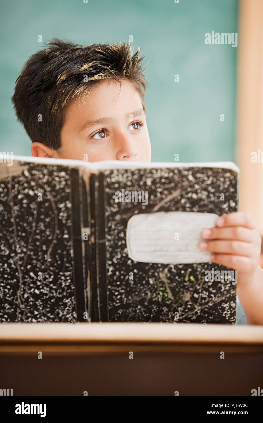 Schoolboy holding a textbook - Stock Image