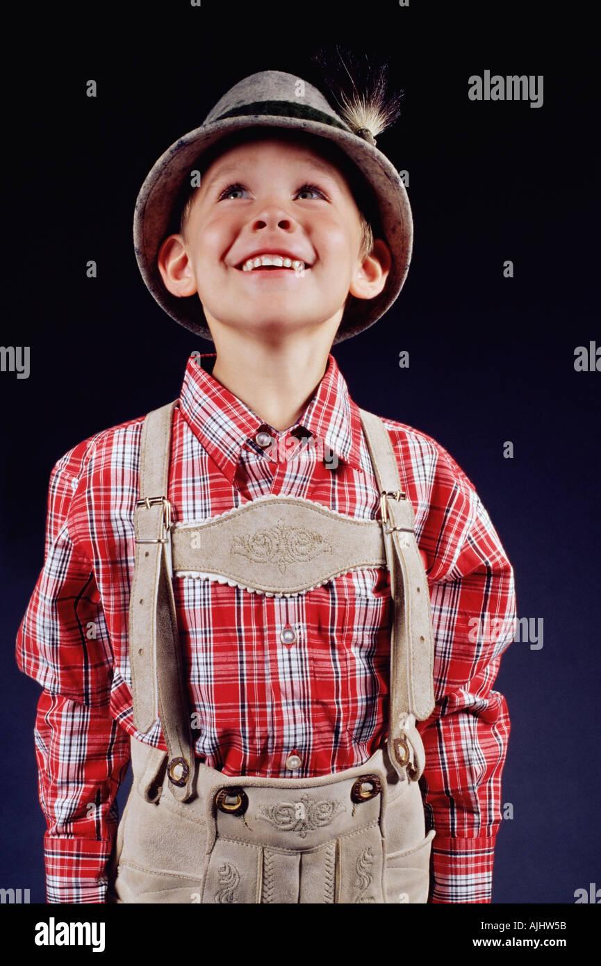 Boy wearing lederhosen - Stock Image
