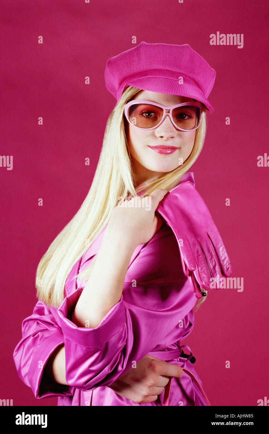 Young woman in pink outfit - Stock Image