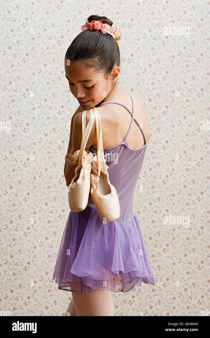 Girl with ballet shoes - Stock Image