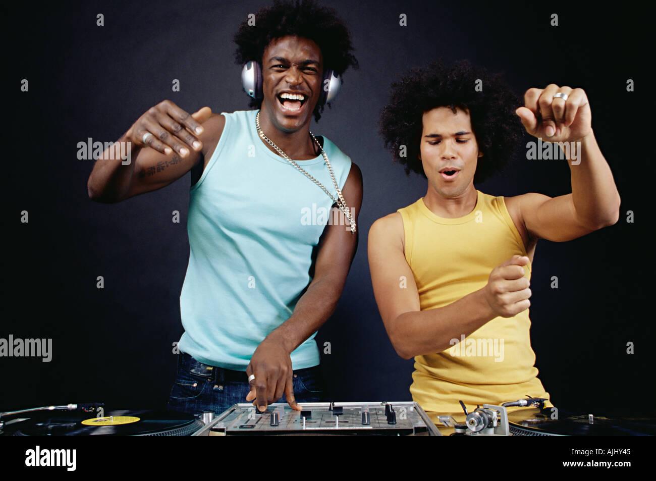 Two young men DJing - Stock Image