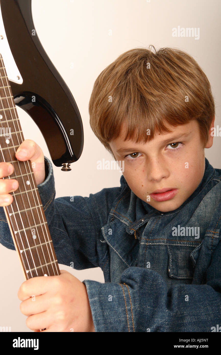 Young boy with electric guitar rock star attitude - Stock Image