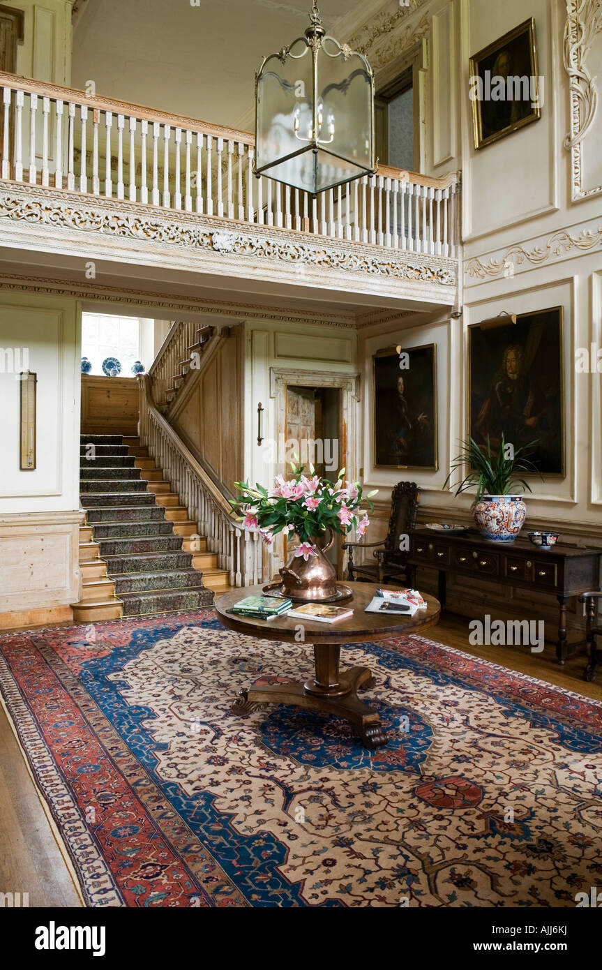 Reception room/ hall with persian carpet and staircase in 17th century Irish castle - Stock Image