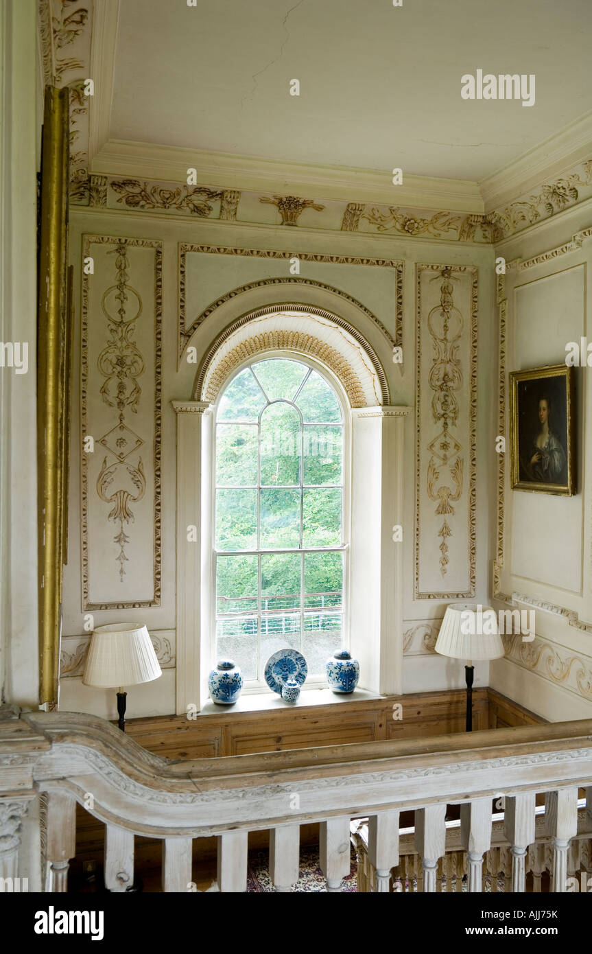 View of ornate grand arched window with gold detail cornice in 17th century Irish castle - Stock Image