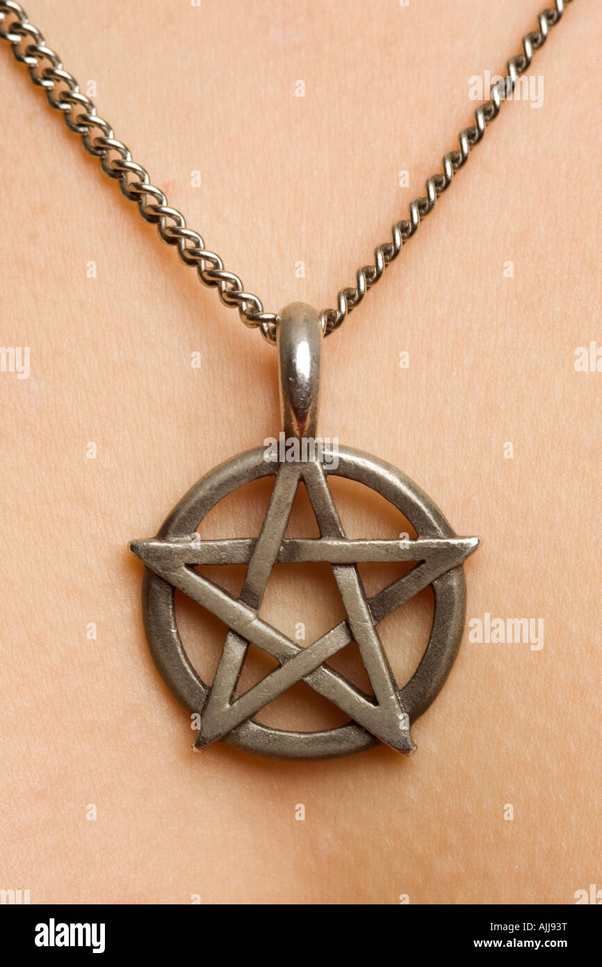 pentagram on necklace jewellery worn by a young woman - Stock Image