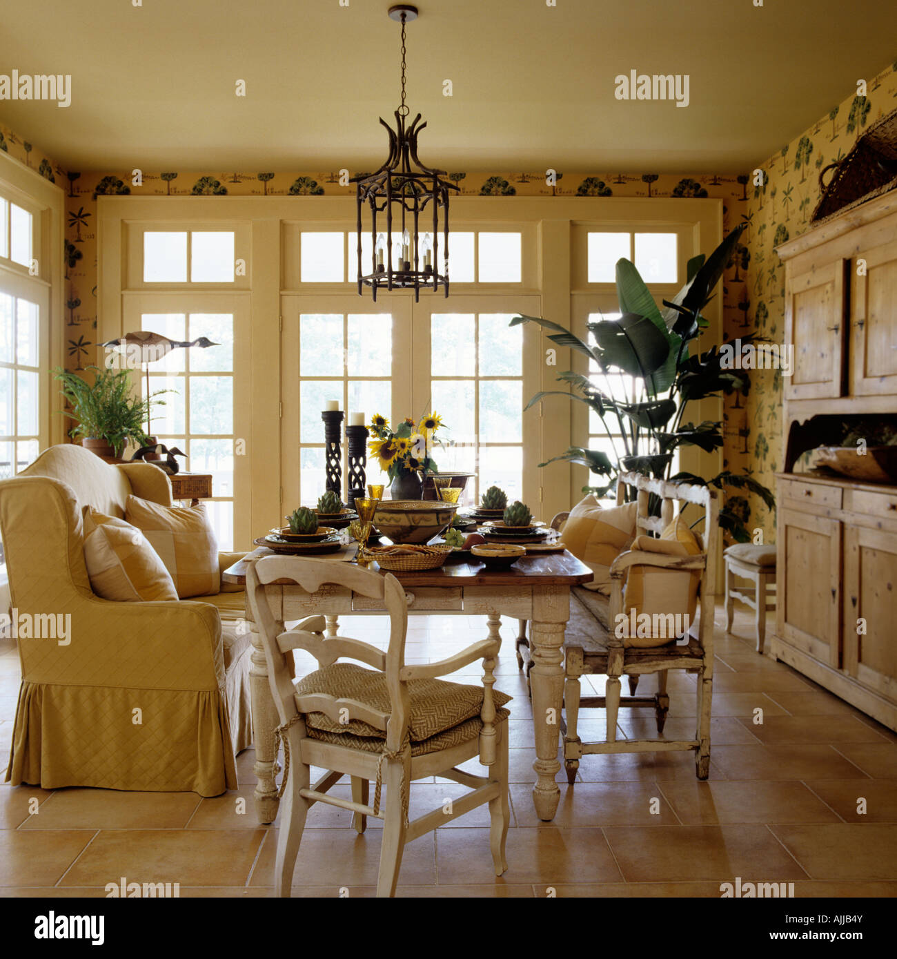Dining Table With Sofa And Chairs In Bright Morning Room