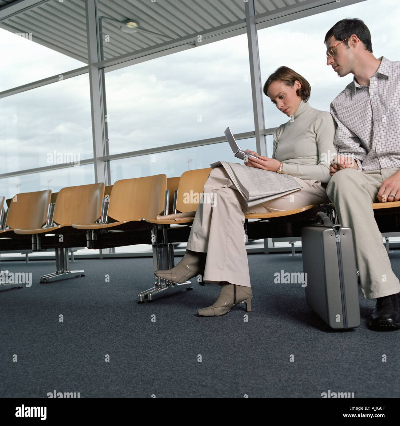 Two colleagues in a departure lounge - Stock Image