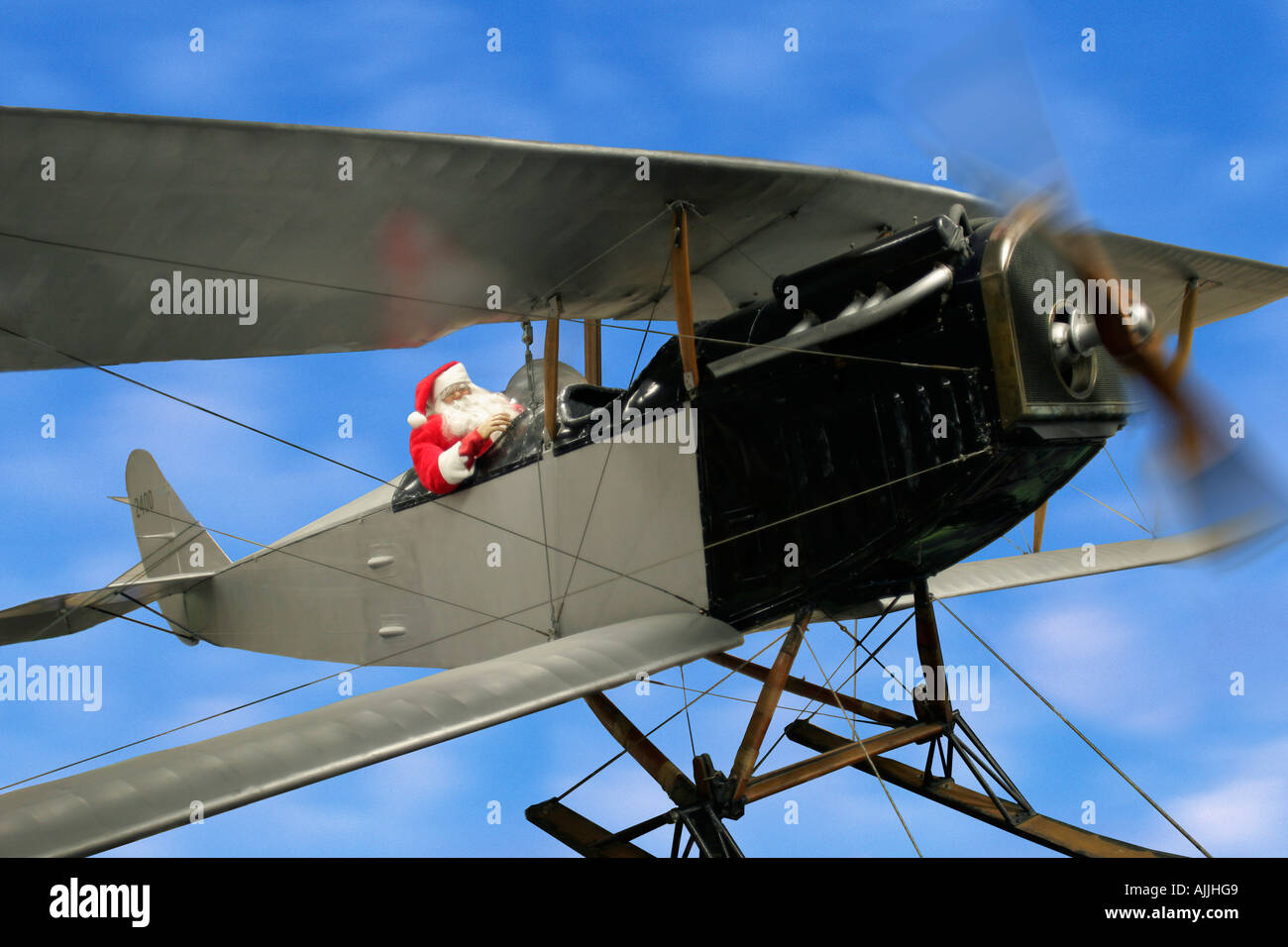 Santa Flying bi-plane Over Alaska Digital Composite Winter - Stock Image