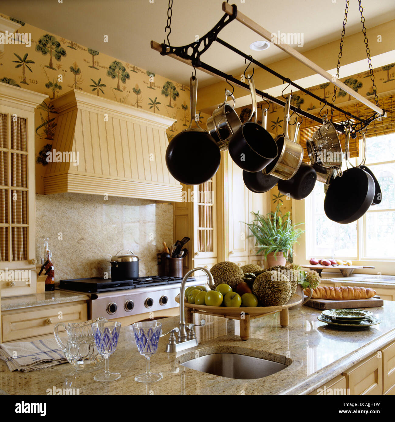 Kitchen With Marble Top Surface And Saucepans Hung From