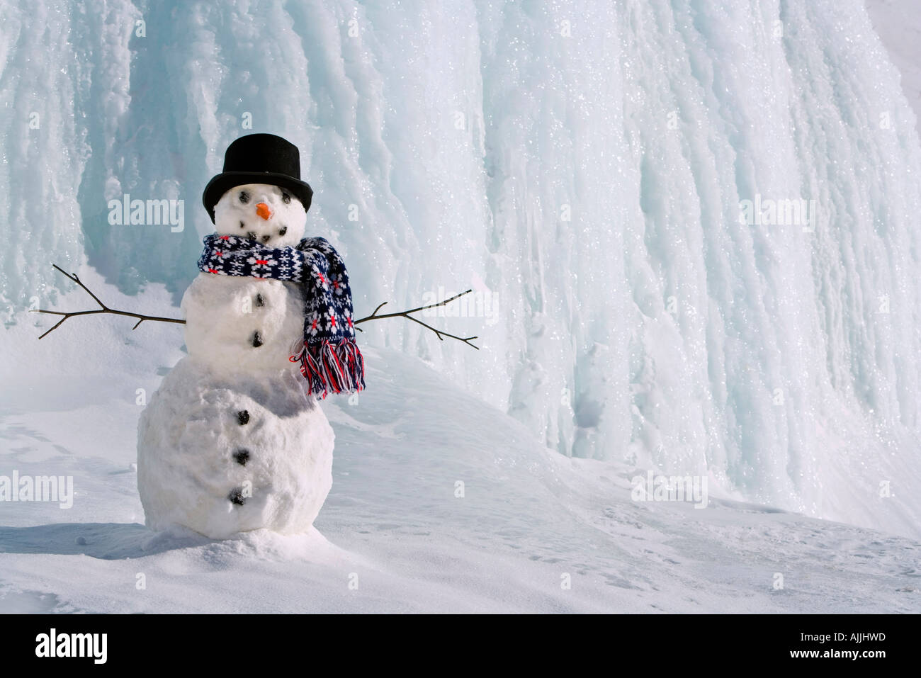 Snowman in front of frozen waterfall along Parks Highway Interior Alaska Winter - Stock Image