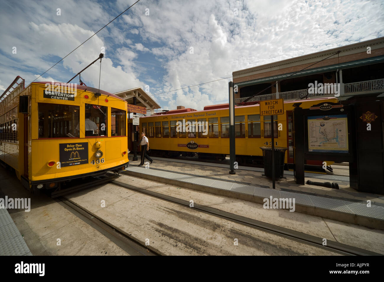 Tampa Florida US historic Spanish district Ybor City TECO Line electric trolley streetcar at Centro Ybor stop with - Stock Image