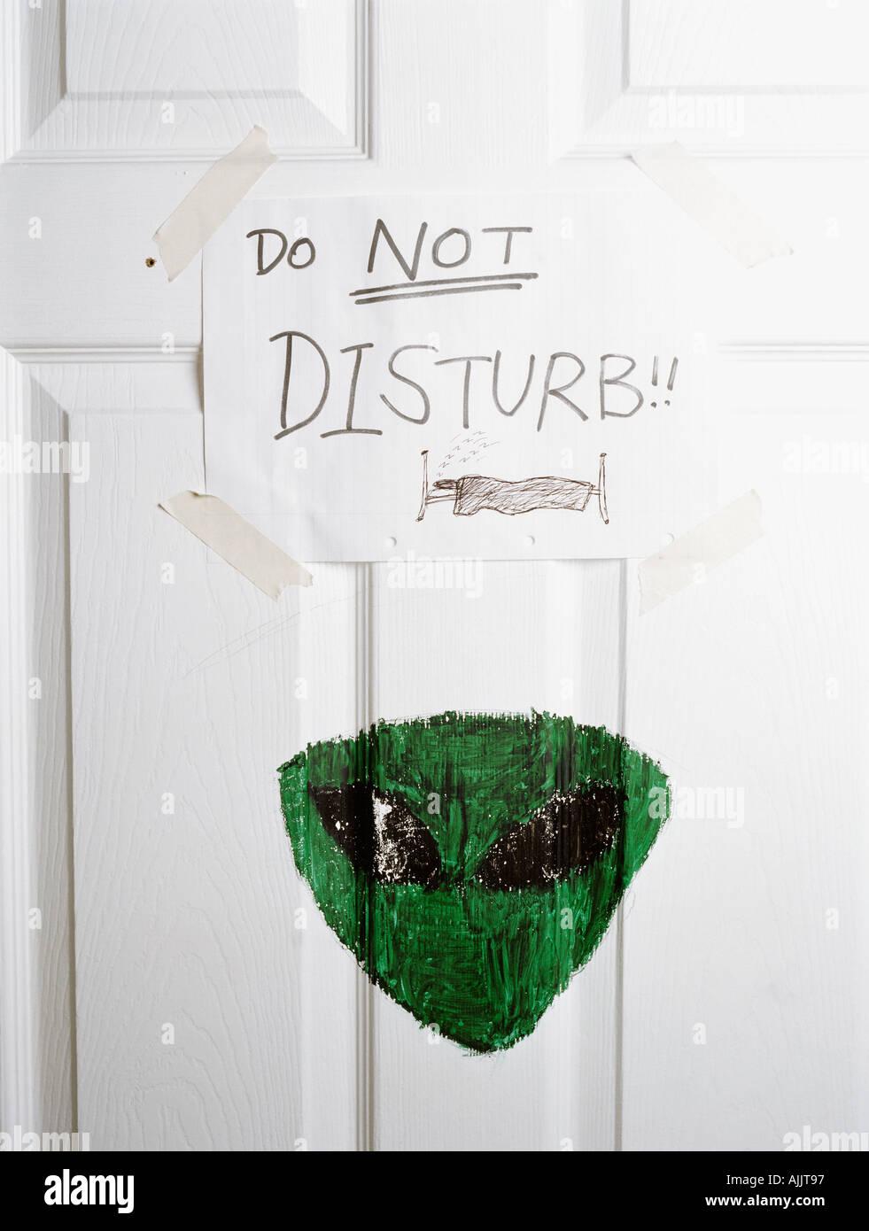 Do not disturb written on door Stock Photo