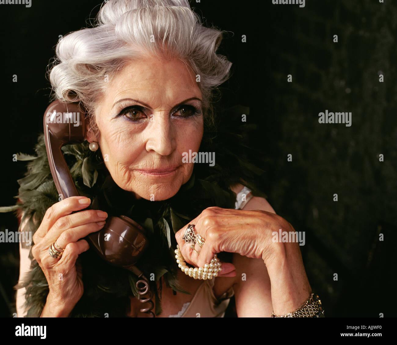 Glamorous senior woman on the telephone - Stock Image