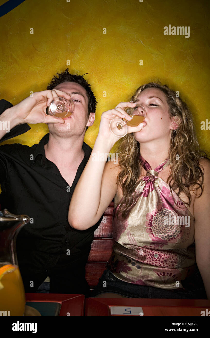 Young couple drinking alcohol - Stock Image
