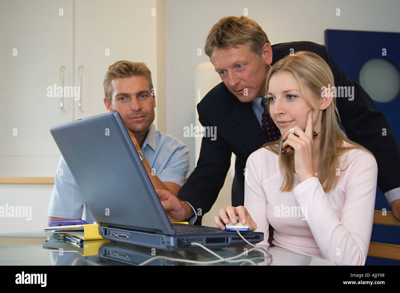 Couple meet with financial adviser - Stock Image